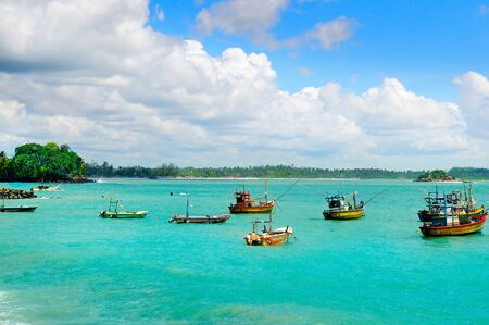 Colorful fishing boats and trawlers at a sea in Sri Lanka. Srilanka Tourism