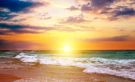 Bright sun rise over the sea. The concept is travel.
