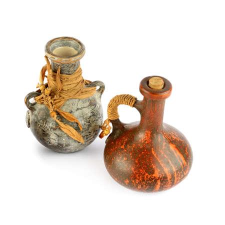 Ceramic vase and clay amphora isolated on white background. Retro style.