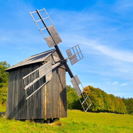 Old wooden windmill. View of Open-air Museum of Folk Architecture and Folkways of Ukraine in Pyrohiv (Pirogovo) village near Kiev, Ukraine