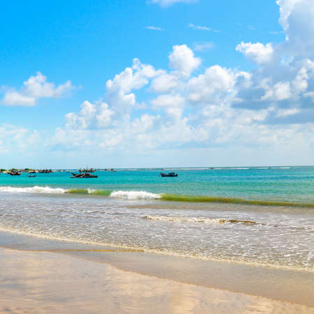 Beautiful seascape with wide sandy beach and clear blue water. The concept of tourism and outdoor activities. Stock fotó