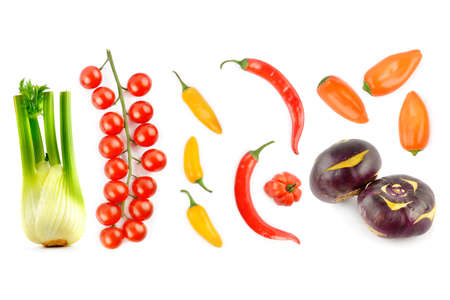 Cherry tomatoes, chili peppers, kohlrabi and fennel bulb isolated on white background.