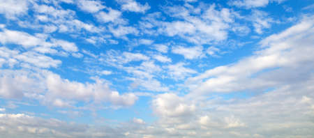 Blue sky with beautiful natural white clouds. Wide photo.