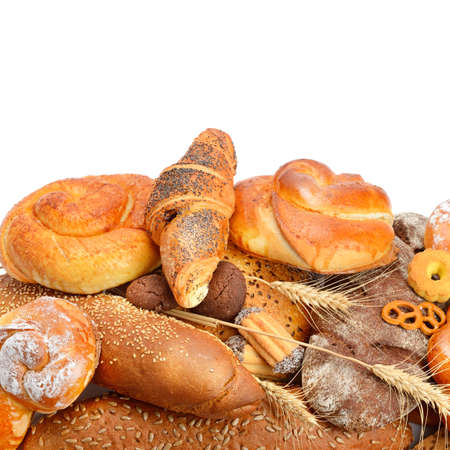 Assortment of bread, buns and croissant isolated on white background. Healthy food. Free space for text.