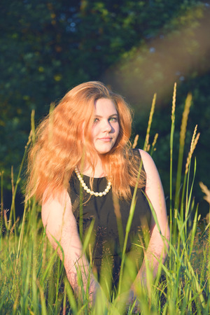 necklase: Womans red hair shining like sun