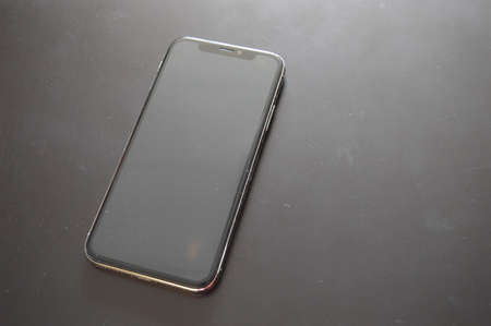 iPhone phone is on a dark background