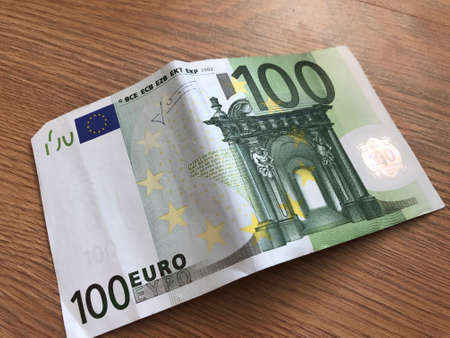 100 Euro banknote on a light background