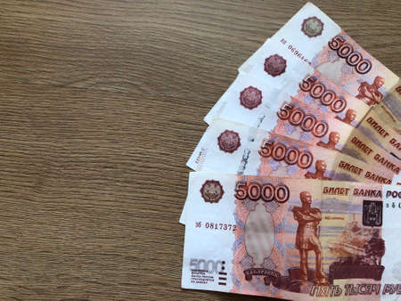 five thousand rubles paper bills on a light background