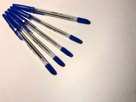 blue pens on white background