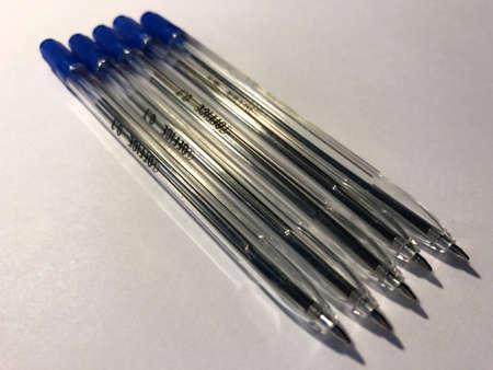 blue pens on white background