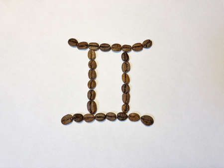 isolated zodiac signs from coffee beans on the white background Stock Photo