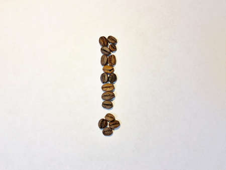exclamation mark of coffee beans. Isolate