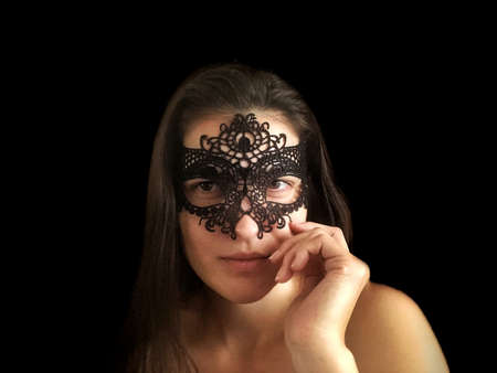 Beautiful girl in lace mask. Female face close up.