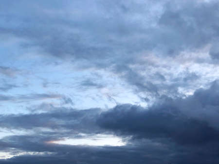 blue sky is covered by blue clouds