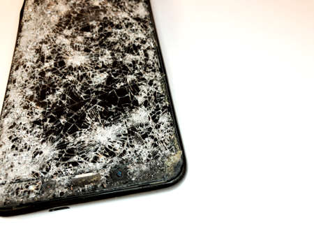 Broken glass mobile phone on a white background Stok Fotoğraf