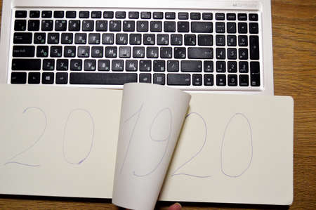 laptop and notebook in which it is written 2019 2020. Stock fotó