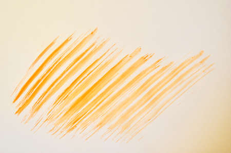 Yellow abstract hand-painted brush stroke daub background over vintage old paper Stok Fotoğraf