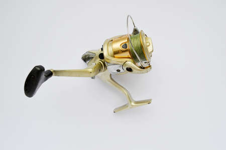 Sea fishing multiplier reel isolated on a white background.