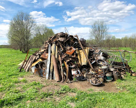 Mountain of scrap metal and garbage in the field. Recycling, sorting, environmental protection. international climate day Zdjęcie Seryjne