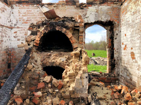 Burned house after fire, ruined building room inside, disaster or war aftermath concept Stock Photo