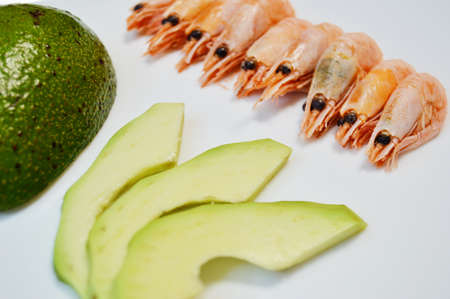 shrimp and sliced avocado on a white background. Banque d'images