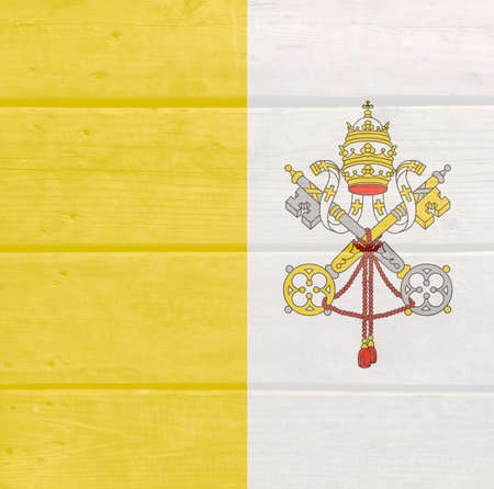 Vatican flag painted on wood plank background. Brushed natural light knotted wooden board texture. Wooden texture background flag of Vatican