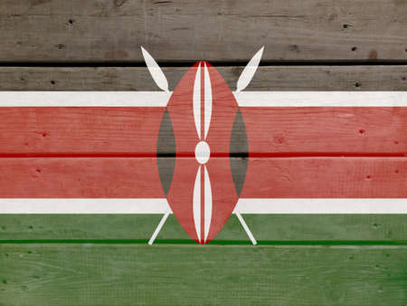 Kenya flag painted on wood plank background. Brushed natural light knotted wooden board texture. Wooden texture background flag of Kenya
