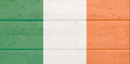 Ireland flag painted on wood plank background. Brushed natural light knotted wooden board texture. Wooden texture background flag of Ireland