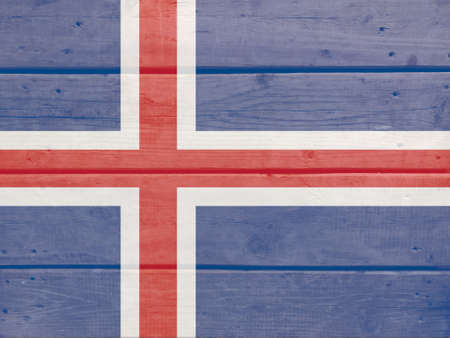 Iceland flag painted on wood plank background. Brushed natural light knotted wooden board texture. Wooden texture background flag of Iceland