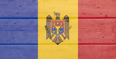 Moldova flag painted on wood plank background. Brushed natural light knotted wooden board texture. Wooden texture background flag of Moldova