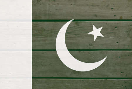 Pakistan flag painted on wood plank background. Brushed natural light knotted wooden board texture. Wooden texture background flag of Pakistan
