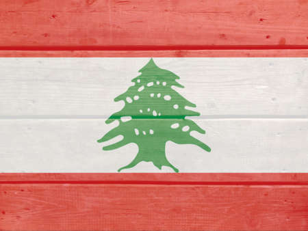 Lebanon flag painted on wood plank background. Brushed natural light knotted wooden board texture. Wooden texture background flag of Lebanon Stock fotó