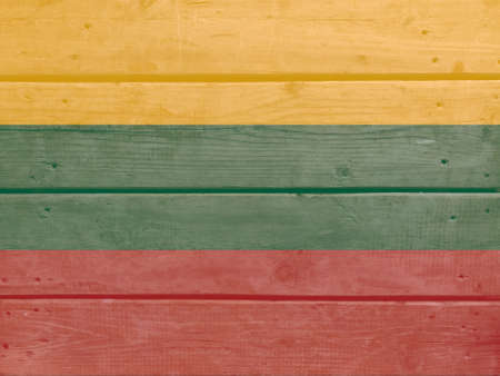 Lithuania flag painted on wood plank background. Brushed natural light knotted wooden board texture. Wooden texture background flag of Lithuania