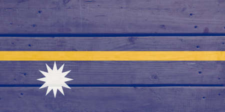 Nauru flag painted on wood plank background. Brushed natural light knotted wooden board texture. Wooden texture background flag of Nauru Stock fotó