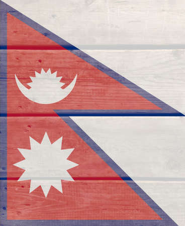 Nepal flag painted on wood plank background. Brushed natural light knotted wooden board texture. Wooden texture background flag of Nepal