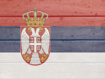 Serbia flag painted on wood plank background. Brushed natural light knotted wooden board texture. Wooden texture background flag of Serbia