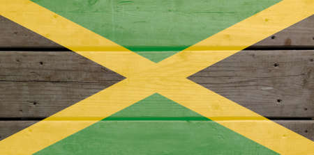 Jamaica flag painted on wood plank background. Brushed natural light knotted wooden board texture. Wooden texture background flag of Jamaica
