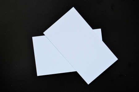 White blank paper on a black background.