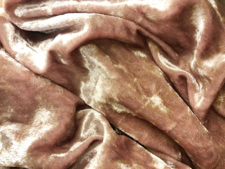 Beige texture of crumpled fabric with pleats