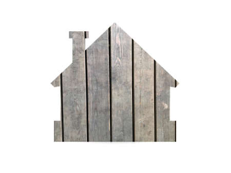 light gray wooden texture for background. Shot through the cut-out silhouette of the house.