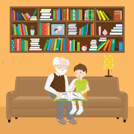 Grandfather and grandson are reading a book while sitting on a sofa.