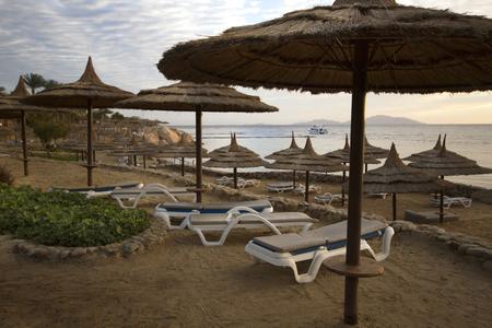 sharm: Straw umbrella on the beach in Red Sea coastline in Sharm El Sheikh, Egypt Stock Photo