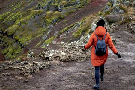 Back view of two women tourists hiking in the mountains in Iceland Banco de Imagens