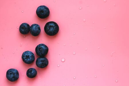Flat lay composition with tasty blueberry and space for text on color pink background Reklamní fotografie
