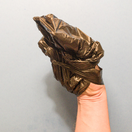 Hand wrapped in plastic