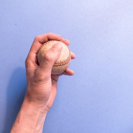 Hand holding a baseball Stock Photo