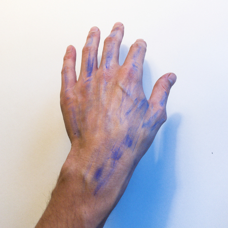 Hand with blue streaks