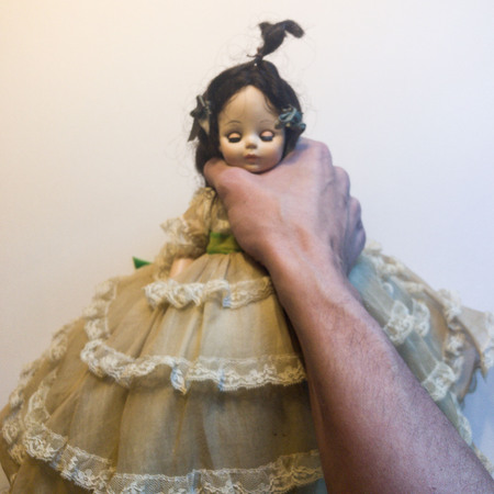 Hand choking doll