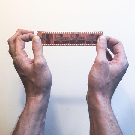 Hands holding film 版權商用圖片