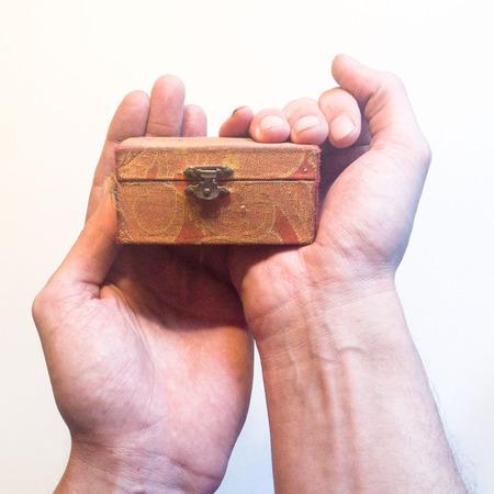 Hands holding orange box
